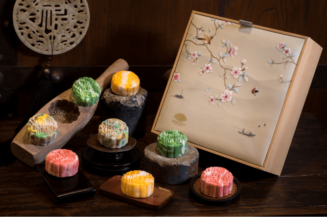 Mandarin Oriental, Singapore's Snowskin collection of mooncakes is inspired by and features tea, a nod to Cherry Garden's curated selection of premium Chinese teas. A box with a variety of colourful mooncakes