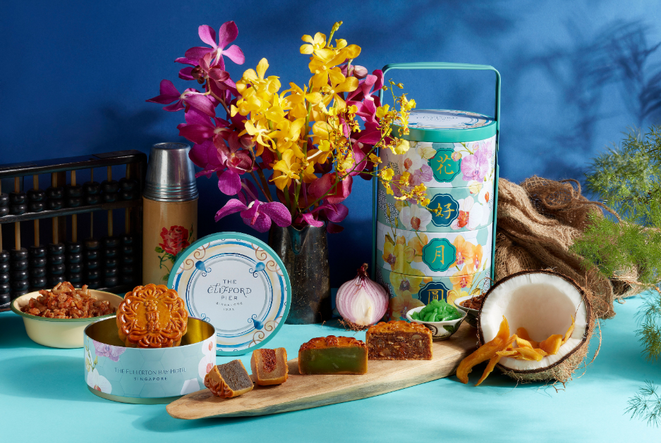 The Fullerton Mooncakes Premium Tingkat Treasures 2020 with a lunchbox and baked mooncakes on blue and turquoise background