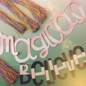 "Unicorn tassels, ""Magical,"" and ""Believe""."