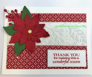 Poinsettia card using Stampin' Up Poinsettia Dies # 153522 and Heartwarming Hugs DSP #153492 which is on sale in October at lyndafalconer.stampinup.net