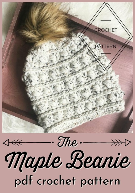 Beautiful puff stitch textured stripes crochet pattern winter beanie. Love this chunky hat pattern and lovely faux fur pompom hat! #crochetpattern #crochethatpattern #crochethat #hatpattern #yarn #crafts #craftevangelist