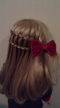 I did a double waterfall braid on Sarahs hair and also added a red bow on the side.