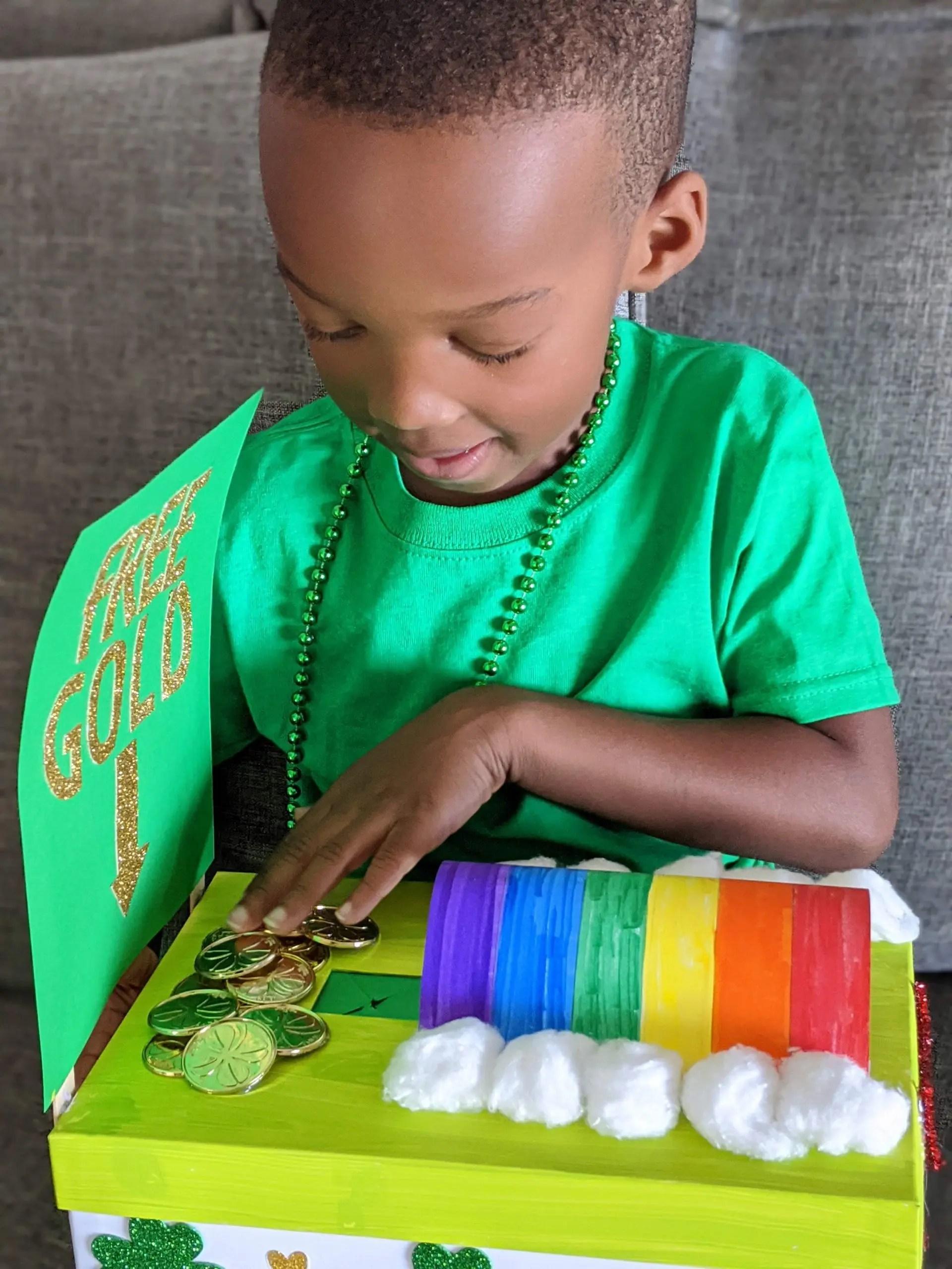 preschooler holding leprechaun trap