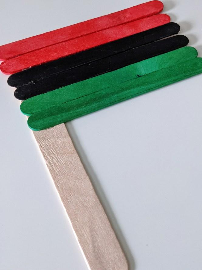 Juneteenth craft stick flag for kids