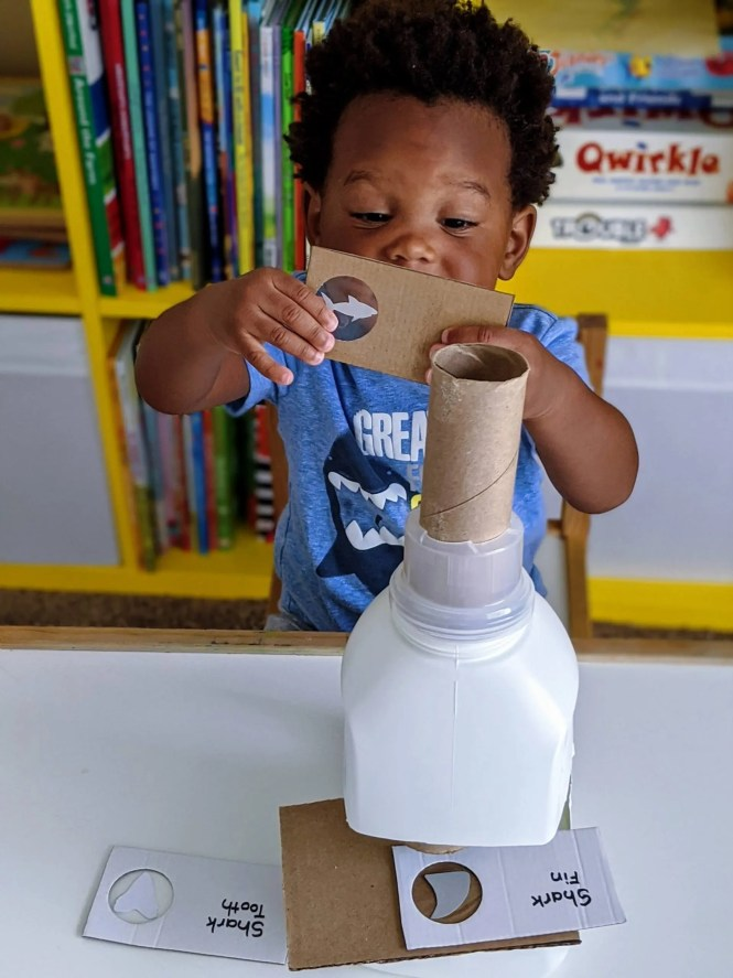 toddler playing with homemade toy for dramatic play