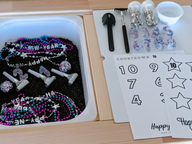New Year's Sensory Bin with free printable
