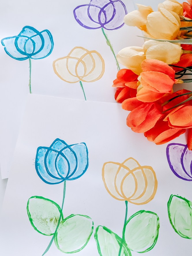 beautiful tulip stamp art using toilet paper roll. easy spring craft for preschoolers and older children