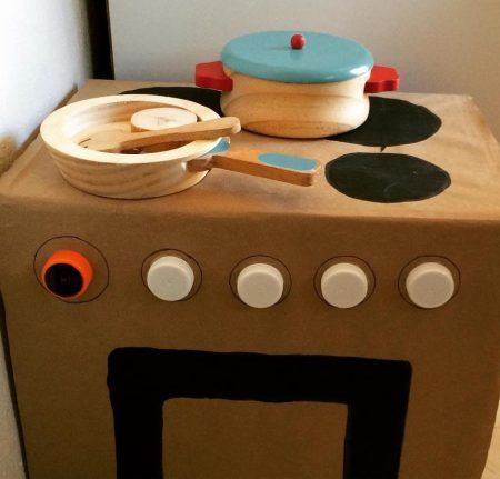 DIY cardboard stove made of up-cycled materials with cute little wooden pots
