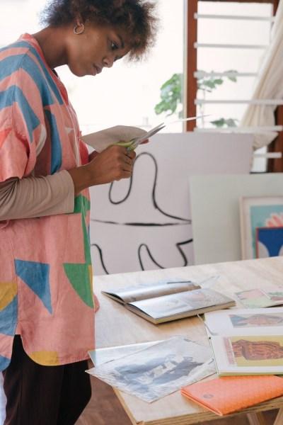 women designer making paper cutouts
