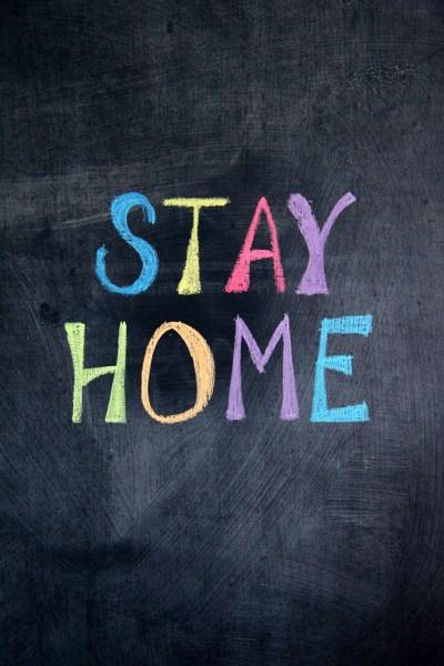 multicolored stay home written on chalkboard