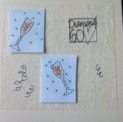 cross stitch champagne flutes on textured cream card
