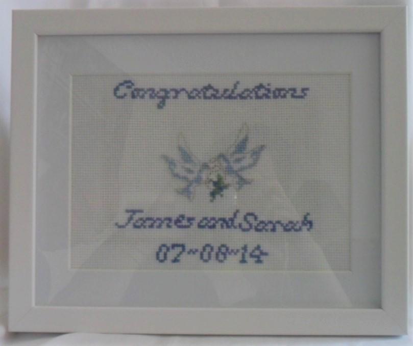 cross-stitch wedding sampler with dove design