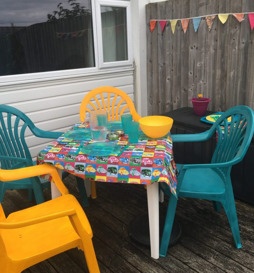 Upcycled garden furniture painted bright teal and yellow