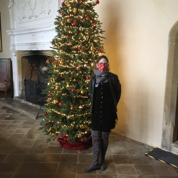 Me standing by the tree in the great hall at Trerice