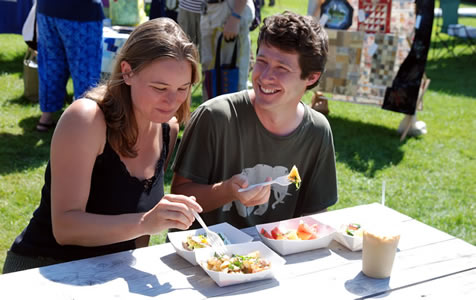 Tim Patterson & Emily Kniffin enjoying each other and freshly prepared food at the Craftsbury Farmers' Market.