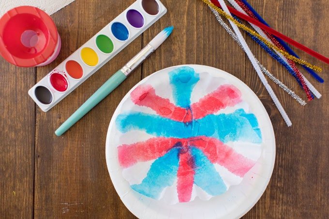 painted coffee filter on a paper plate