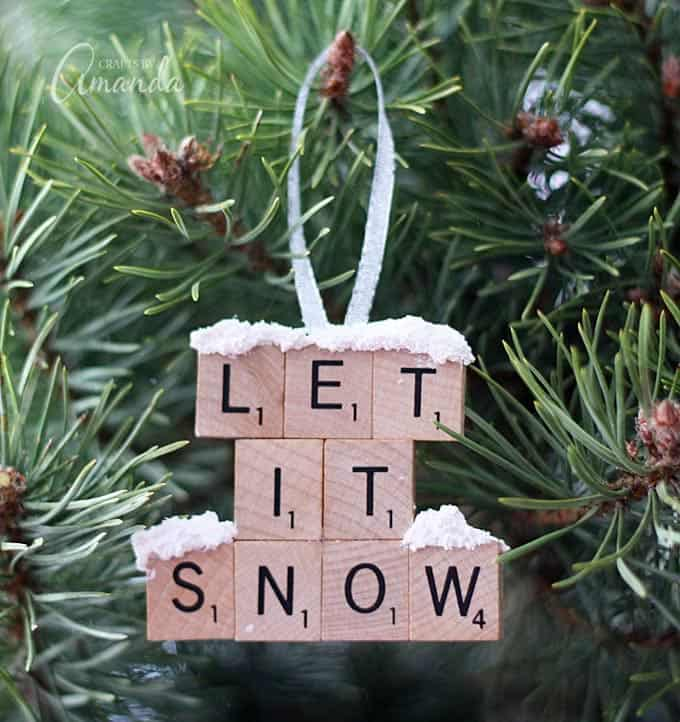 "Make a ""Let It Snow"" scrabble tile ornament from scrabble tiles and snow texture paint! So easy to make, you will need a paper plate and some felt too, great to give as gifts! A fun Christmas ornament project for kids and adults."