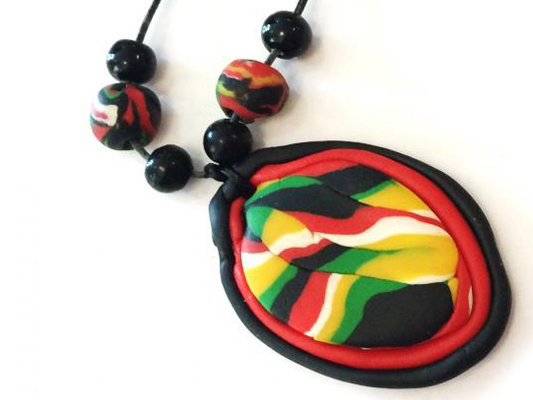 A pendant made from brightly coloured oven baked clay.
