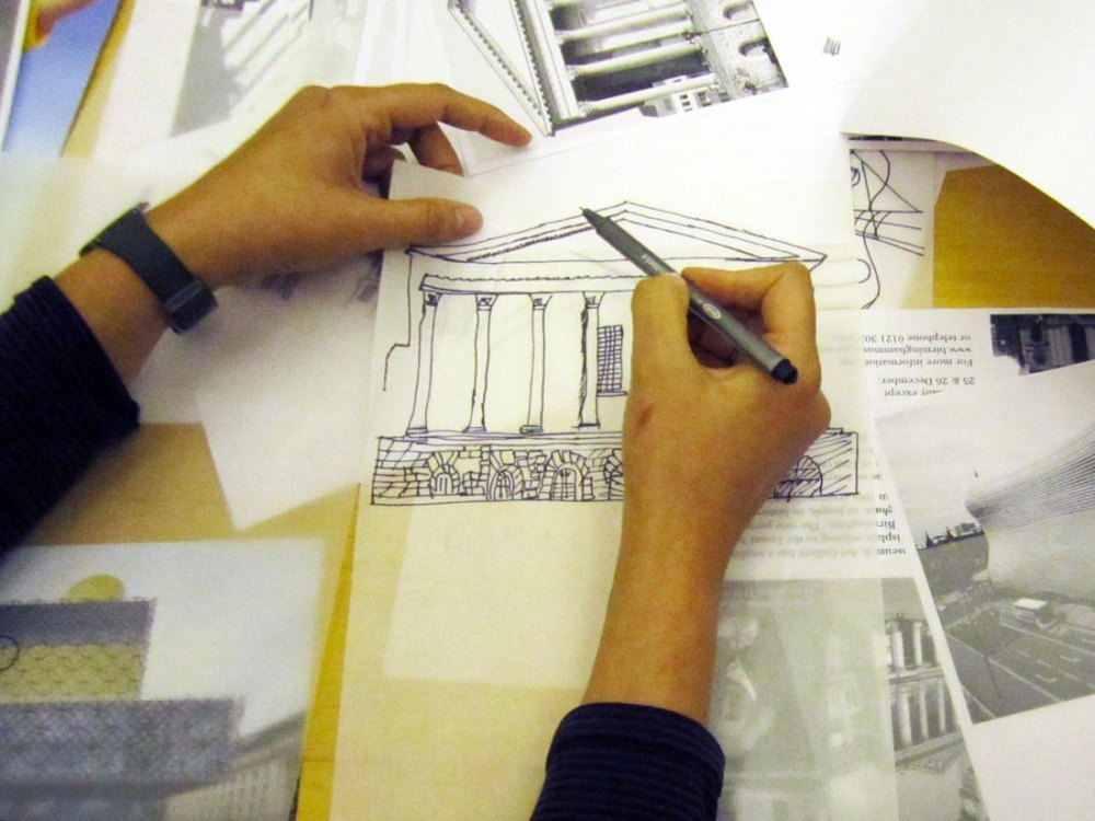 hands designing and drawing Birmingham architecture