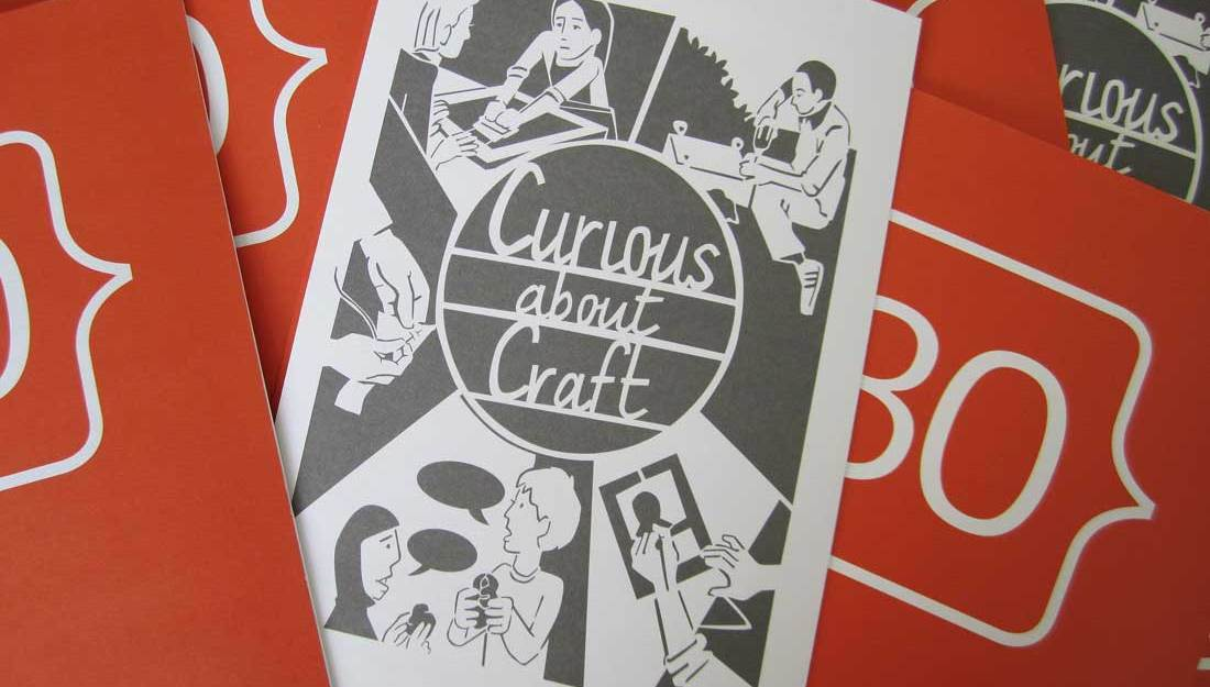 A paper leaflet featuring a design for a papercut featuring people making.