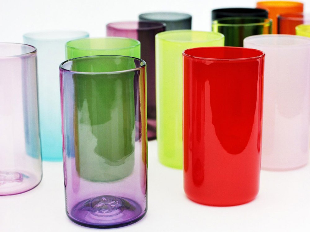 Tall glass beakers of various colours and opacities.