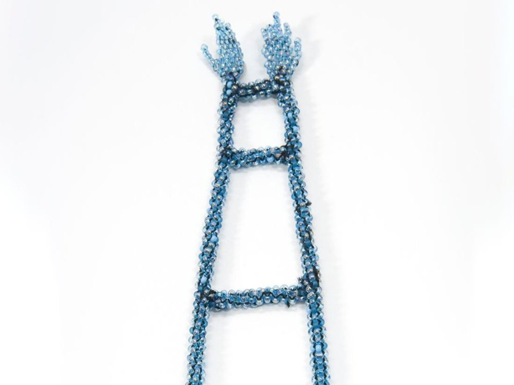 Thread heavily embellished with small blue beads makes the shape of a ladder with hands at the end.