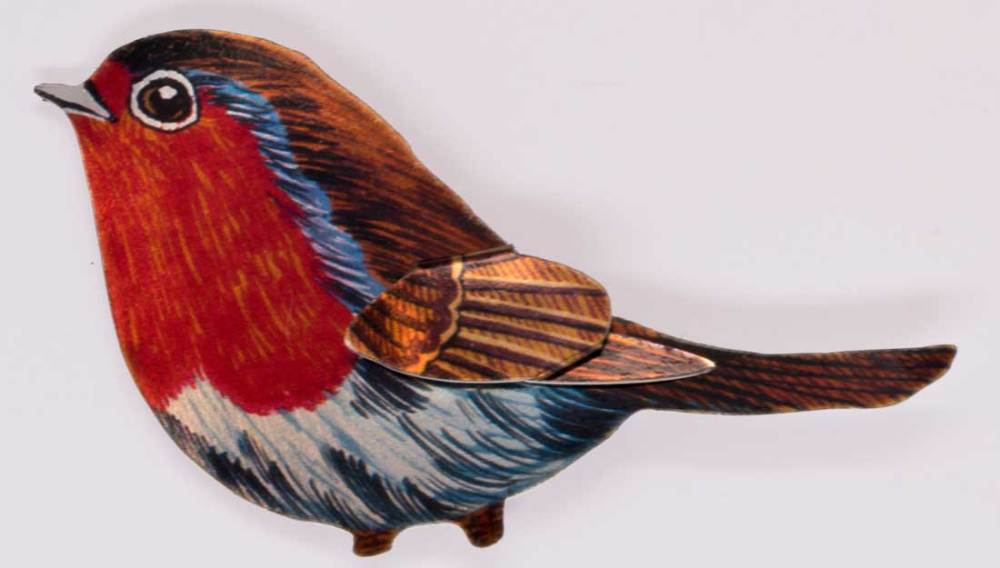 A small metal bird printed with a bright design of a robin.