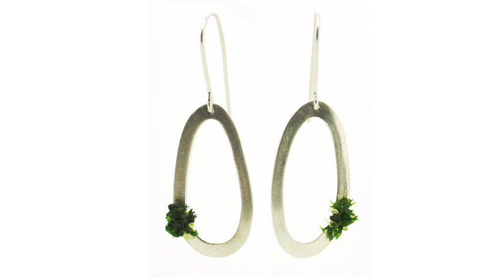 SIlver circle earrings with green mosslike decoration.