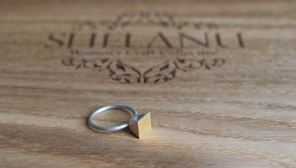 Shelanu Interlocking Stories range ring in part gold, simple square stud design.