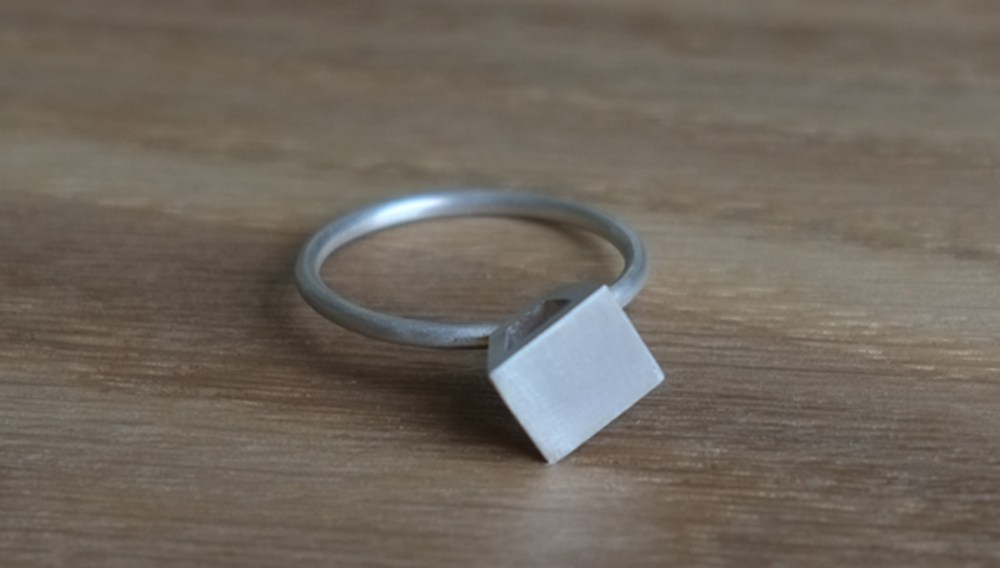Shelanu Interlocking Stories range ring in silver, simple diamond stud design.