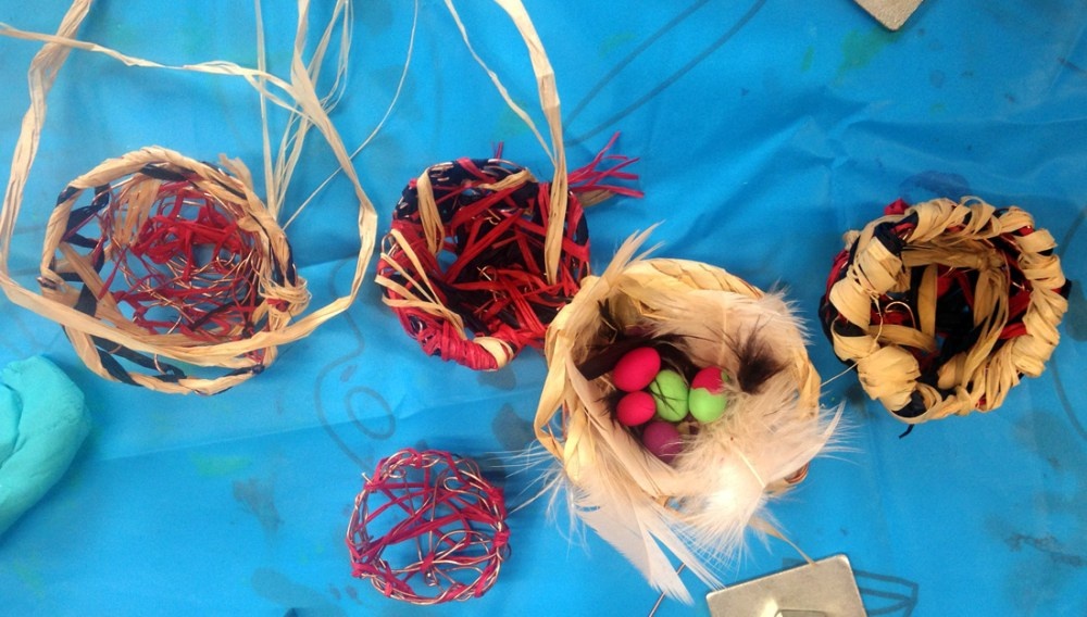 5 nests made using paper, copper wire and feathers.
