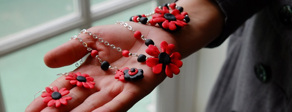 a women displays jewellery she has made on the her hand.