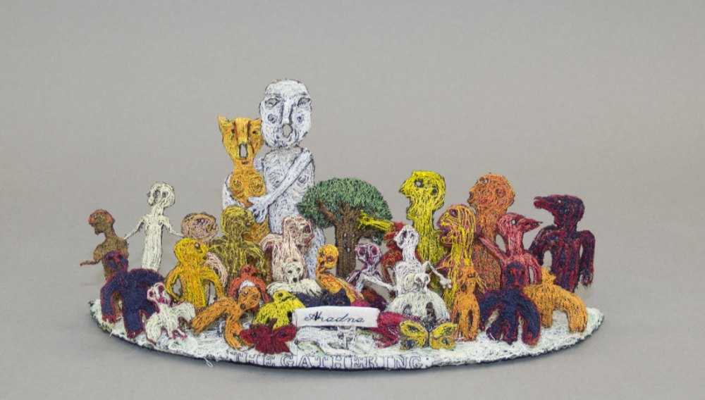 Aradne's colourful embroidered imagined figures grouped together
