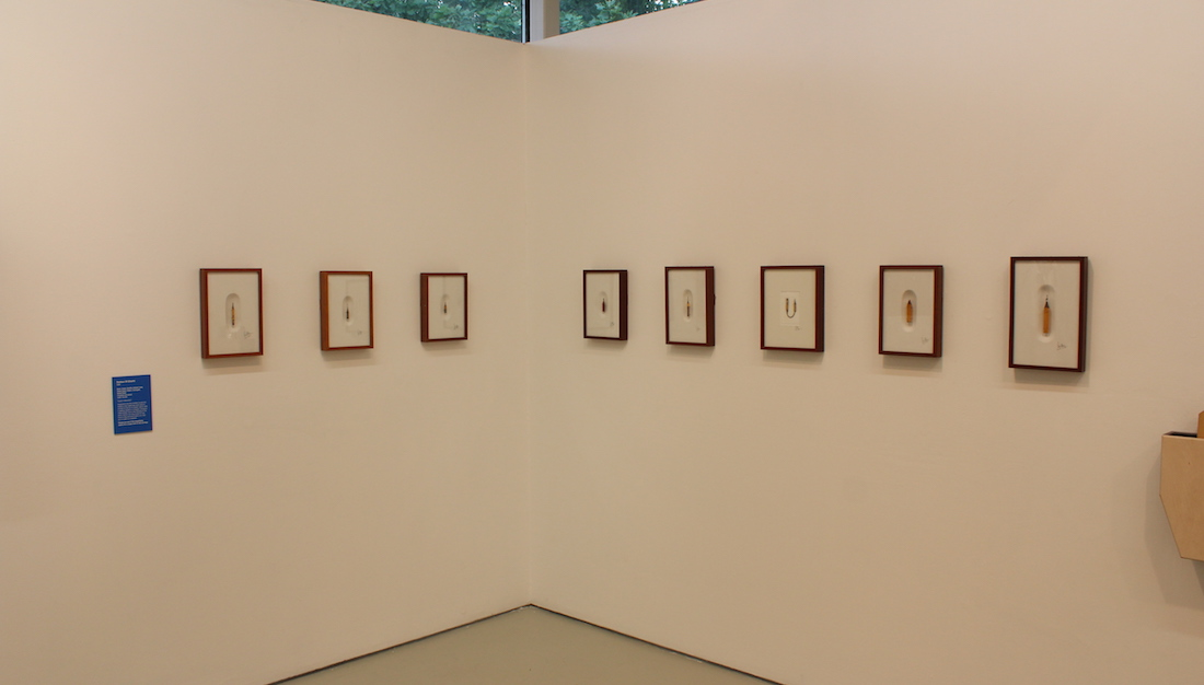 framed Ghetti pencil carvings on gallery walls