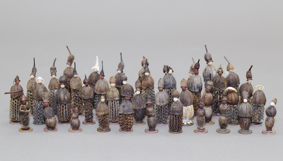 group of little sculptures made from seed pods