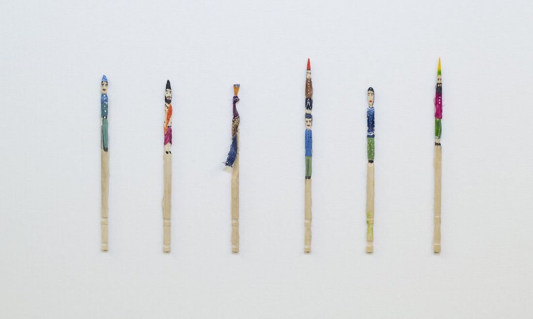 painted toothpicks as persons and peacock