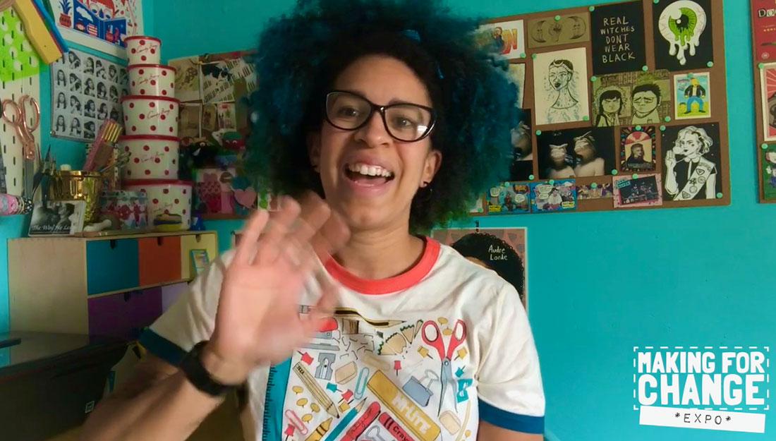 a video still of an artist waving