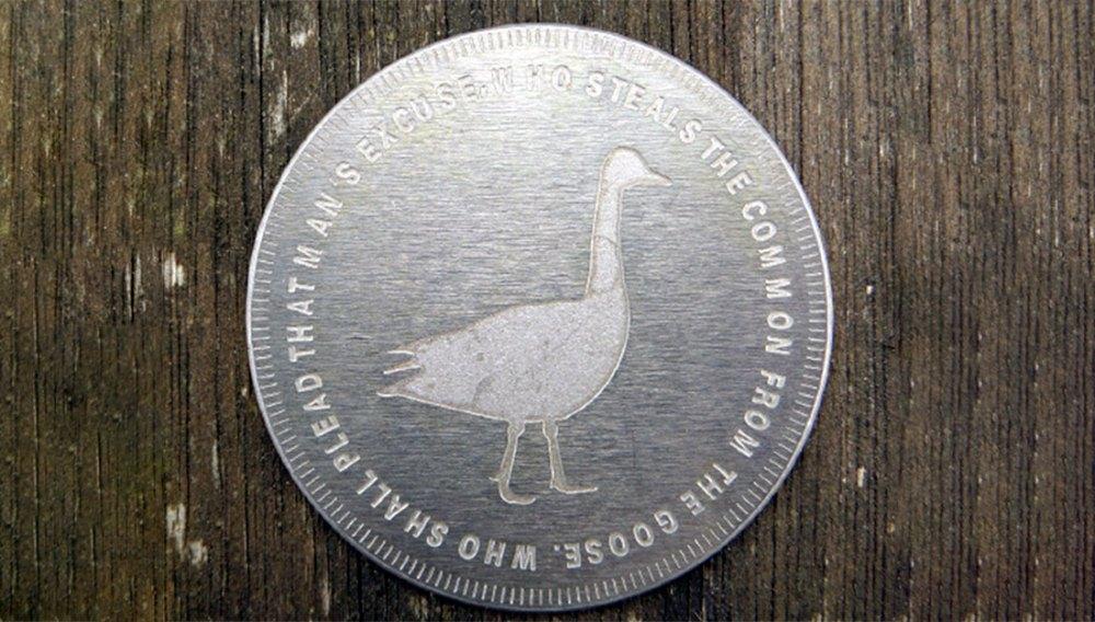 A silver token, like a big coin.