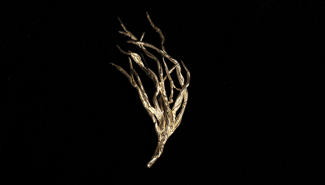 A small branch shaped brooch.