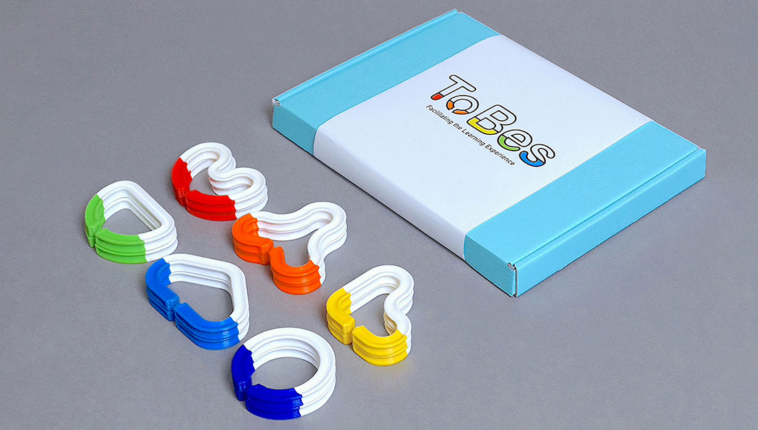 scultpure components made of brightly coloured chainlike pieces.