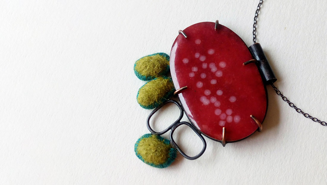 A close up of a pendant made of ovals.