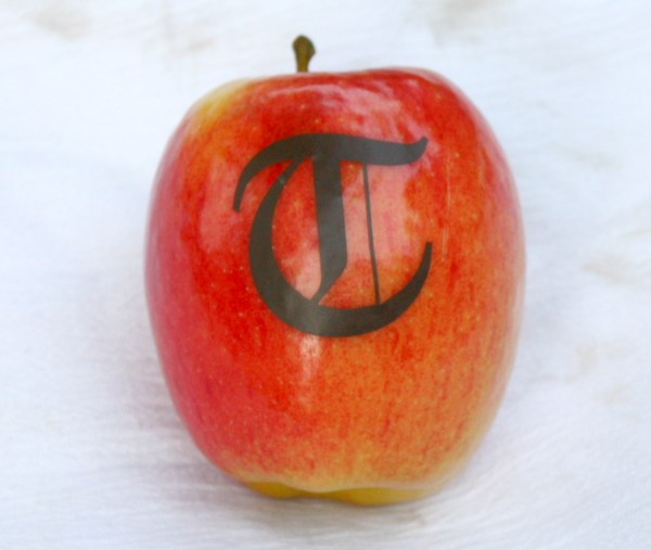 Adhering vinyl letters to apples