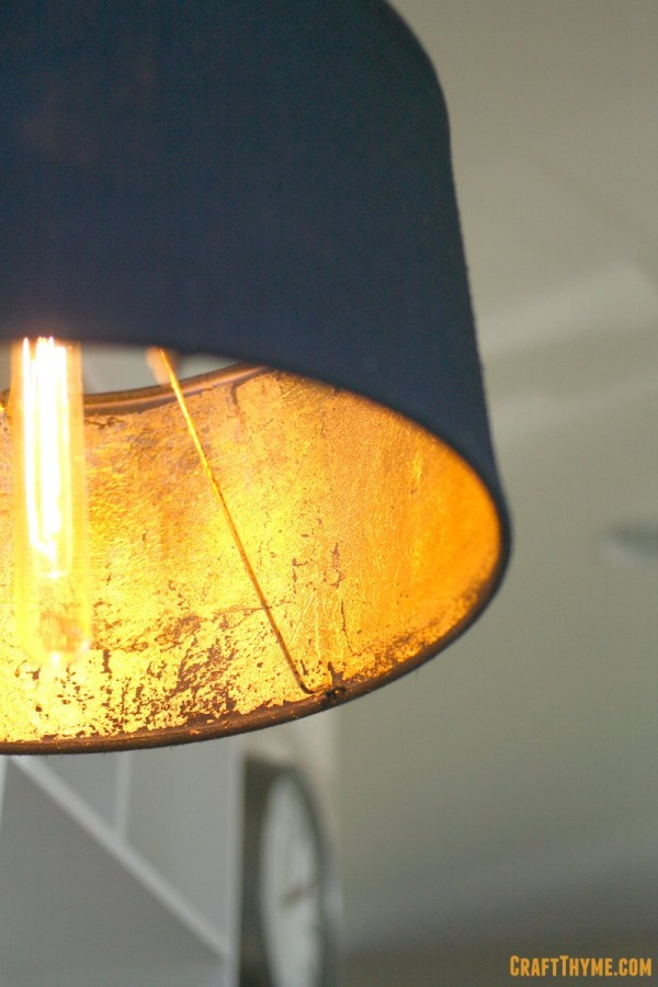 Completed gold leaf lampshade with edison bulb