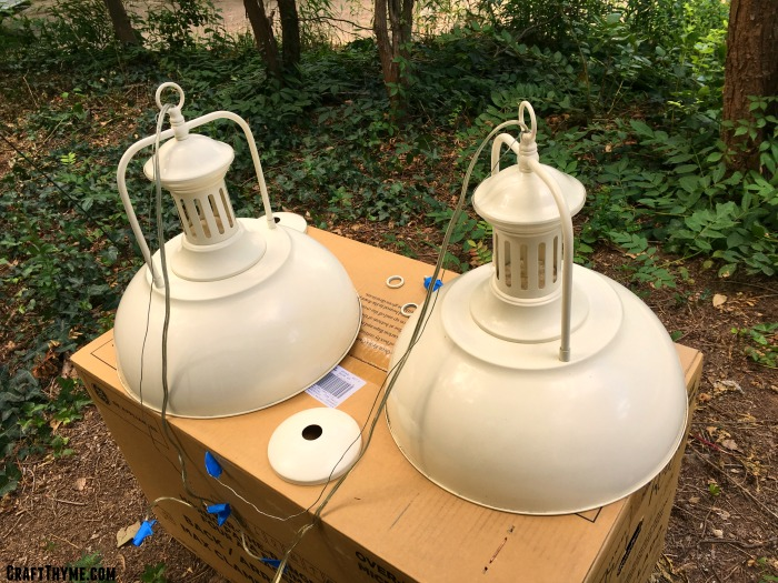 Cream colored bleh lights we found on craigslist before we transformed them into fresh, modern pulley lights.