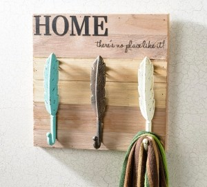 Metal Feather hooks vinyl letters on wood board