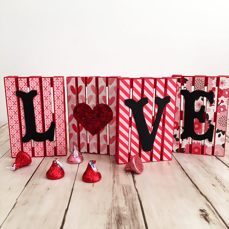 Make these cute Love Mini Pallet Signs at Craft Warehouse