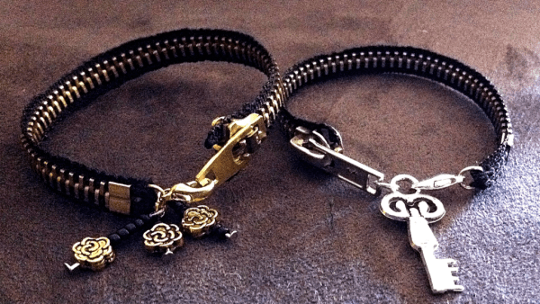 two bracelets made from zippers with charms