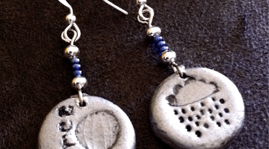 silver hook earrings with blue beads and round clay pendants