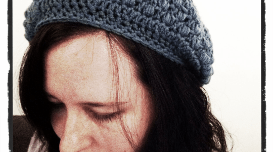 blue and white crochet slouch hat with puff stitches