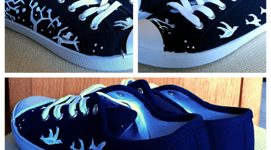 navy canvas shoes painted with white birds and trees